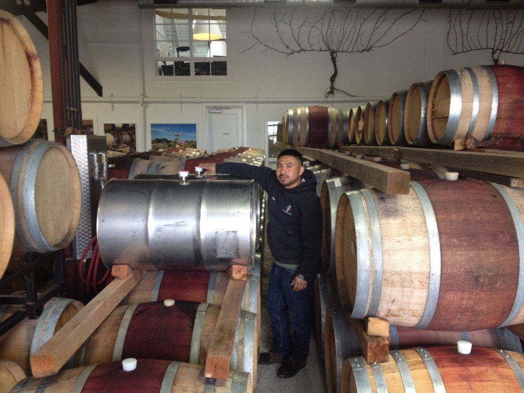 Assistant winemaker Seferino C. from Bedell Cellars putting our barrels to good use!