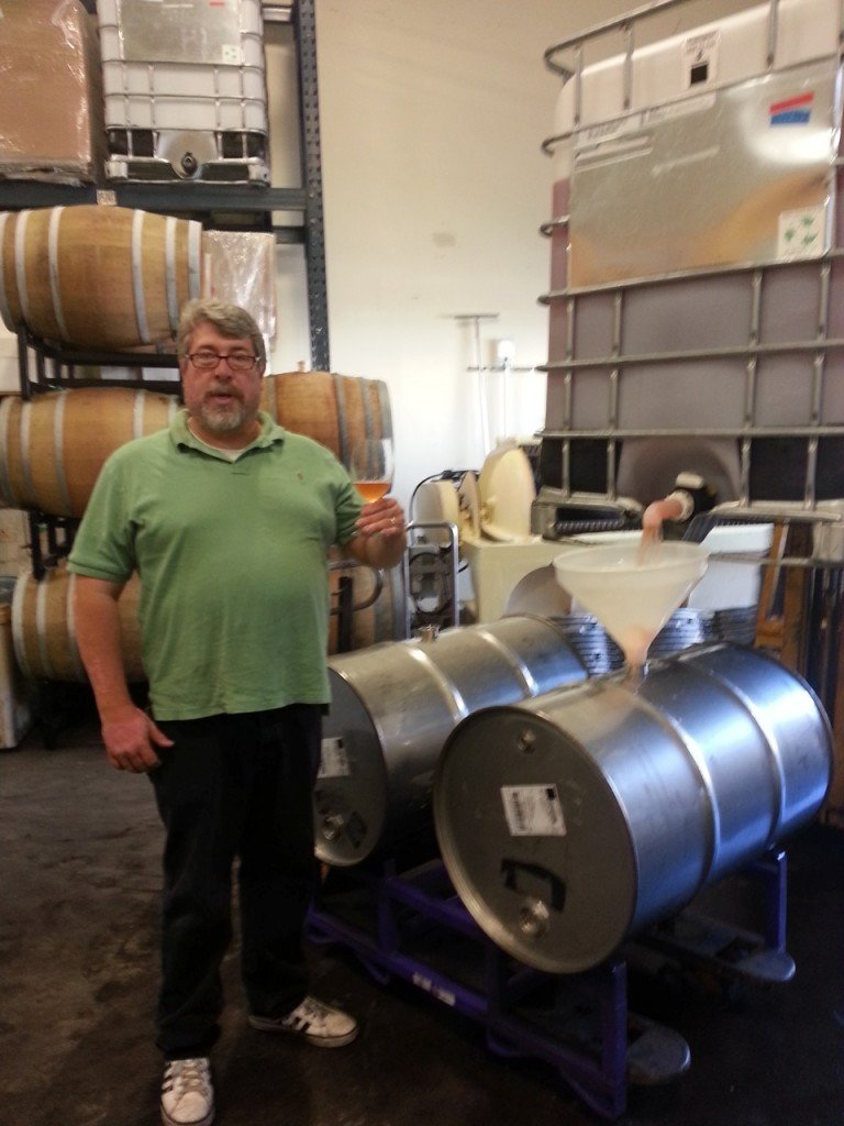 Fred D. from Urbano Cellars showing off his wine barrels!